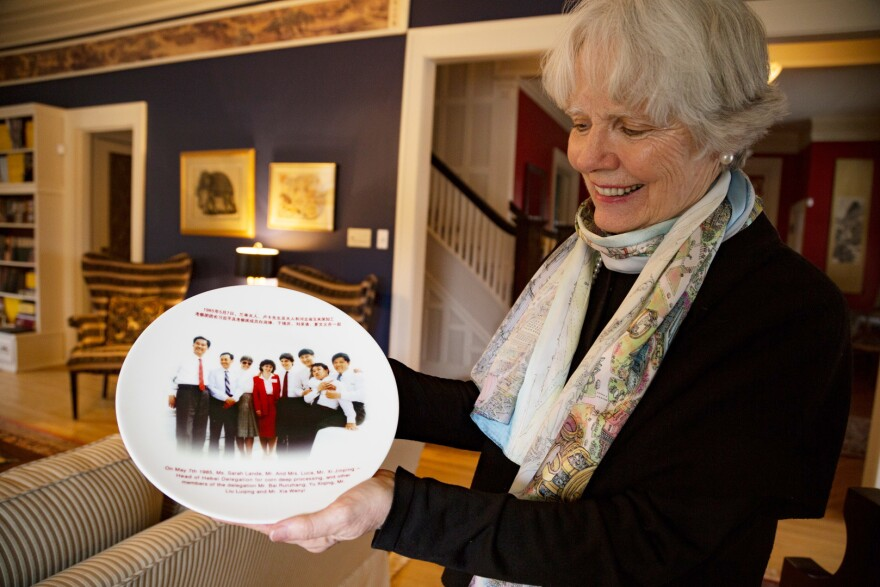 Sarah Lande shows off a plate commemorating Xi Jinping's 1985 trip to Muscatine, Iowa. Lande helped organize Xi's visit that year.