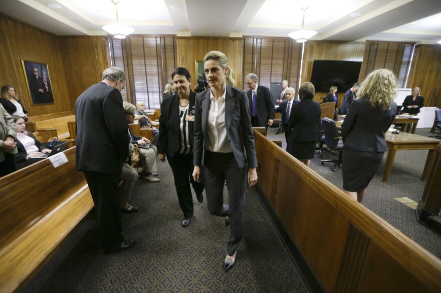 Fox Sportscaster Erin Andrews, who also hosts ABC's <em>Dancing with the Stars</em> (center), in court March 4. She sued a hotel after another guest secretly filmed her nude through a hotel door peephole.