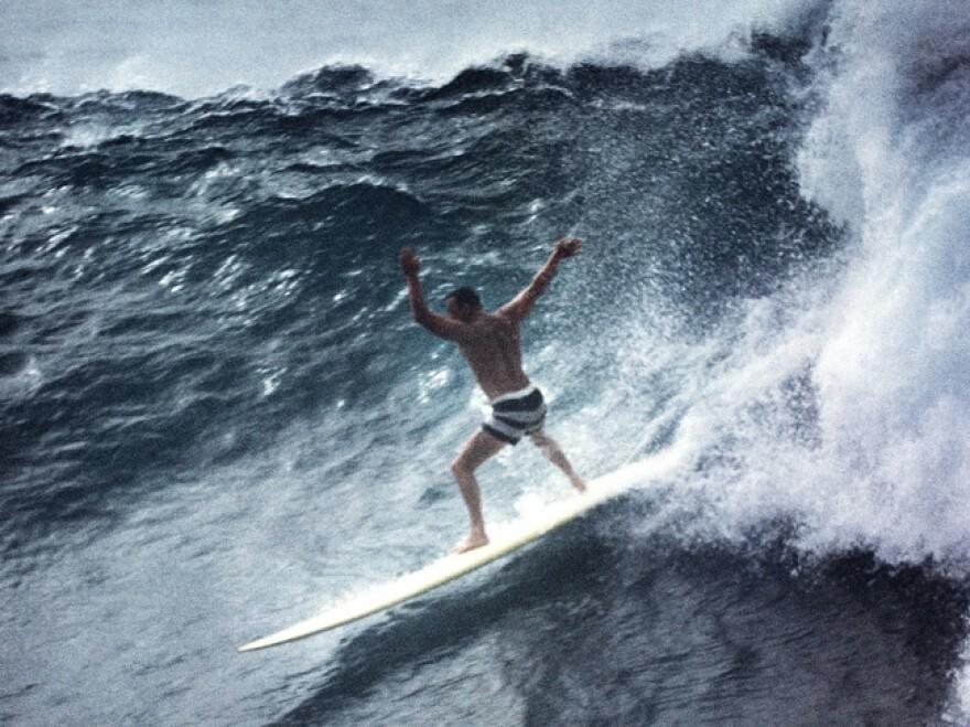 Greg Noll surfing Waimea Bay in Oahu in 1960.