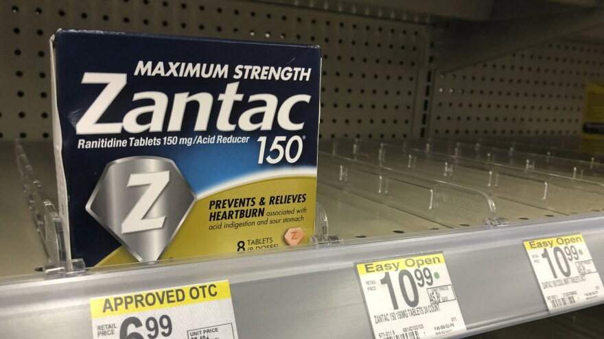 A box of Zantac tablets sits at a pharmacy in Miami Beach, Fla. On Wednesday, U.S. health regulators ordered that the popular heartburn drug be pulled from the market.