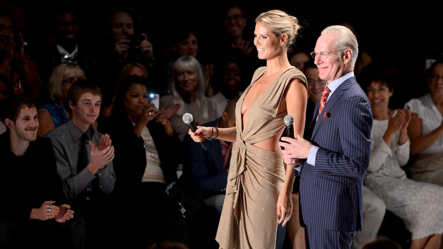 <em>Project Runway</em> host Heidi Klum and Tim Gunn at the Project Runway Spring 2013 fashion show in New York City. Today, Gunn is comfortable before an audience — but it wasn't always that way.