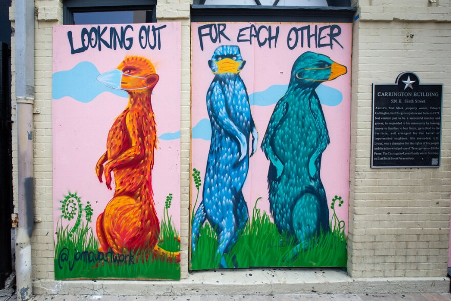 A mural by Jomau on a boarded-up Sixth Street business on May 21.