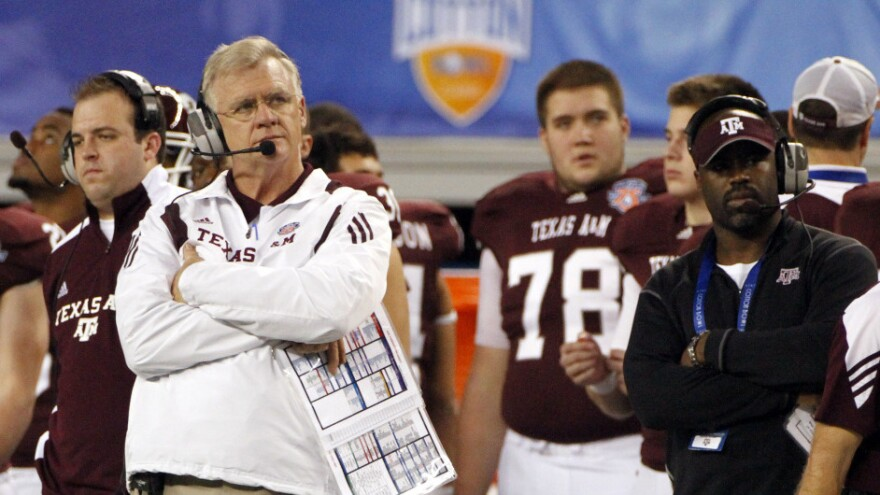 Texas A&M head coach Mike Sherman looks on from the sideline during the Cotton Bowl last fall. Texas A&M has been approved to leave the Big 12 for the Southeastern Conference but is still at risk of lawsuits from Big 12 members.