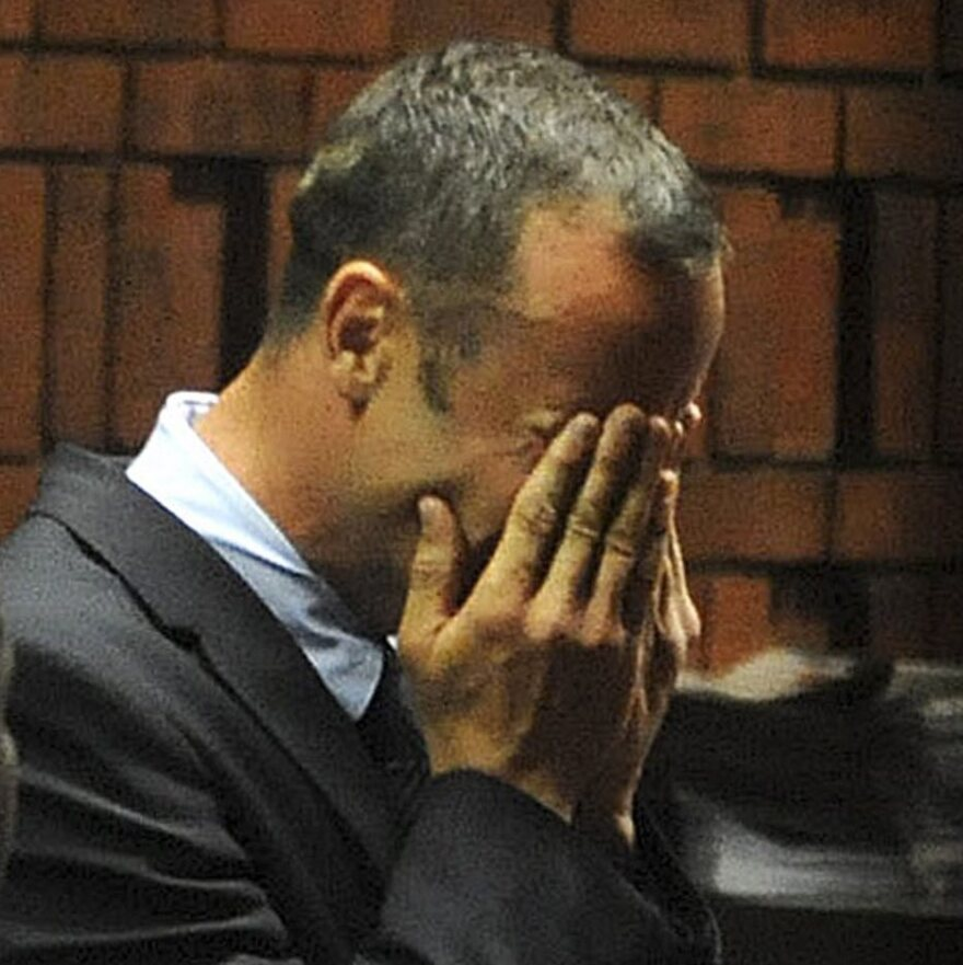 South African Paralympic and Olympic sprinter Oscar Pistorius as he wept today while being charged with murder.