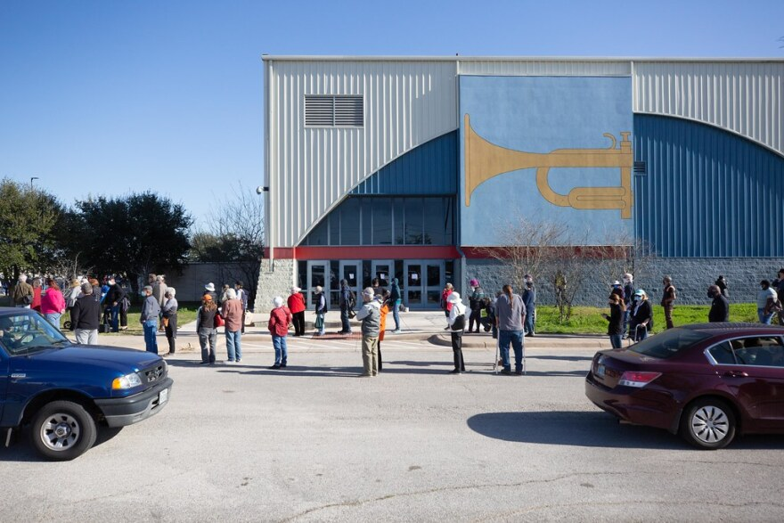 Hundreds wait in line at a vaccination site in Northeast Austin on Jan. 14.