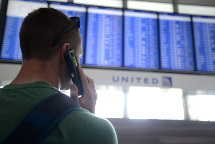 Dennis McCormack of Rockaway, N.J. checks the departure board only to find out that his flight to Newark, N.J. has been canceled at O'Hare International Airport in Chicago.