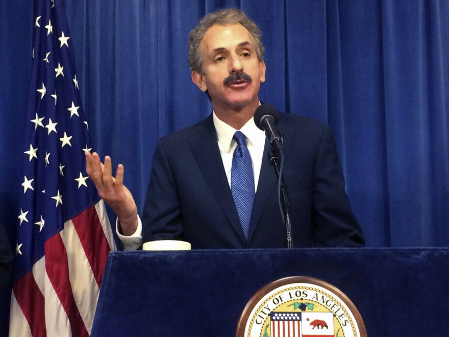 "Los Angeles City Attorney Mike Feuer, seen here in 2017, says his office has asked Wellness Matrix Group to ""cease and desist"" from selling purported at-home COVID-19 tests. Because the FDA has stated that no at-home test kits are approved, Feuer says, ""anyone trying to sell us one is a scammer."""