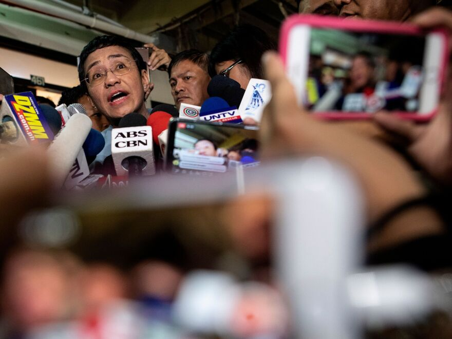 Philippine journalist Maria Ressa gives a statement after posting bail at a regional trial court in Manila on Thursday.