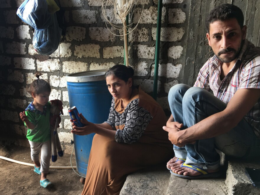 Ashraf Attiya sits with his wife, Fifi, and daughter Sandy. The Christian family was expelled from their village after Attiya was accused of being involved with a married Muslim woman. A mob stripped and dragged his mother through the streets and burned down their house.