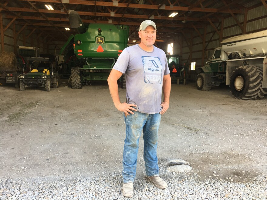 Kansas Farmer Luke Ulrich faces long hours and low pay in part because of Trump's trade policies, but he still backs Trump.