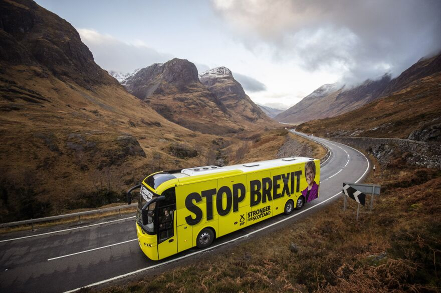 """A Scottish National Party campaign bus — emblazoned with the slogans """"Stop Brexit"""" and """"Stronger for Scotland"""" — travels along the Glencoe Pass in the Highlands during a tour of Scotland on Monday."""