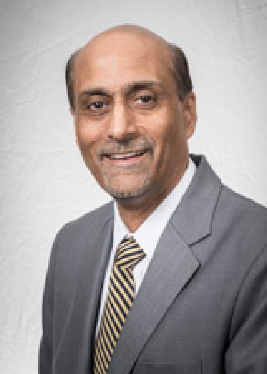 a picture of Dr. Sood in a gray coat and yellow tie