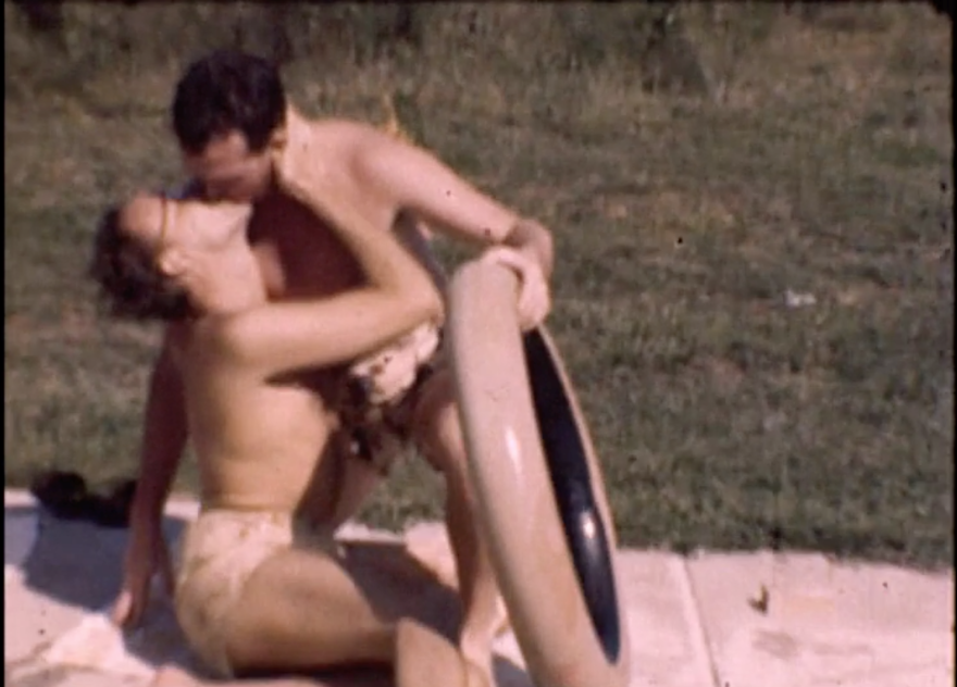 Two unidentified men kiss in this image from the pool-party films shot in 1945.