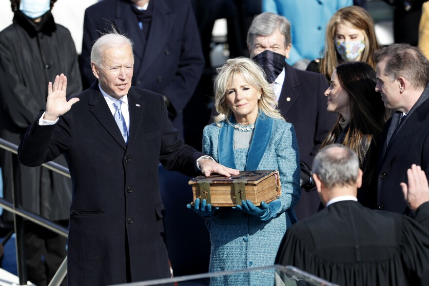 Supreme Court Chief Justice John Roberts administers the oath of office to President-elect Joe Biden.
