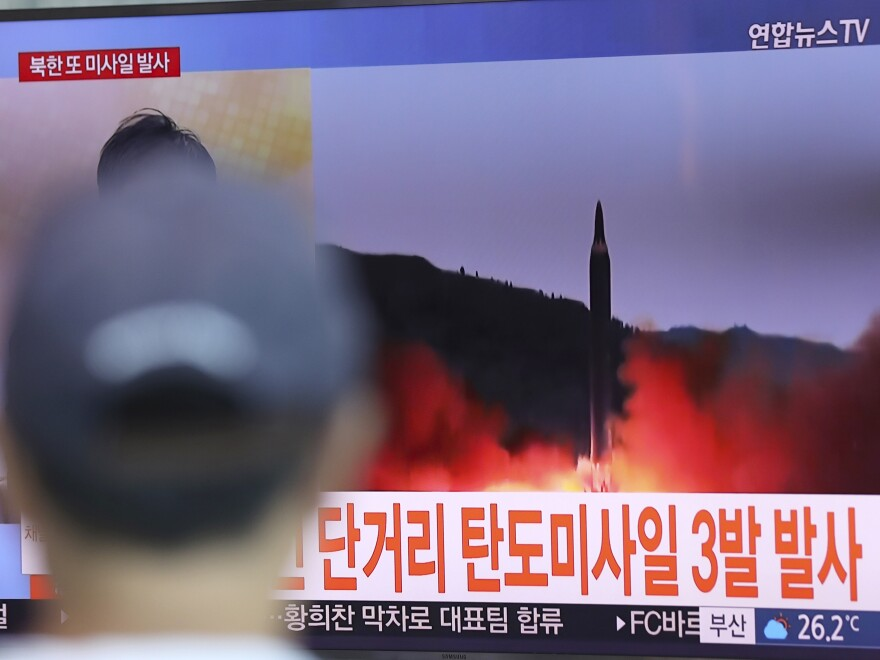 A man in Seoul, South Korea, watches a TV screen on Saturday showing file footage of a North Korean missile launch.