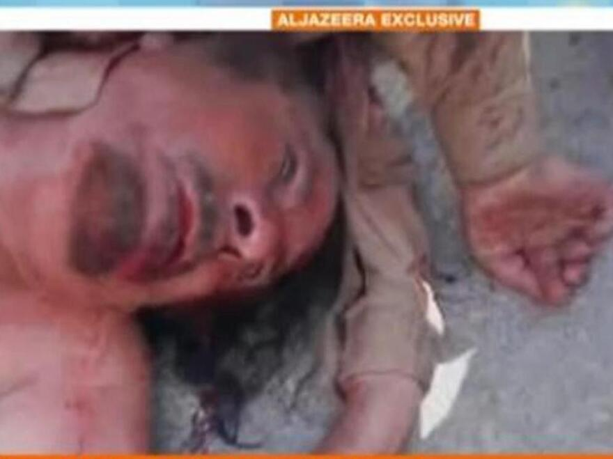 <p>Al-Jazeera English says this image, from a video clip, is of the body of ousted Libyan leader Moammar Gadhafi.</p>