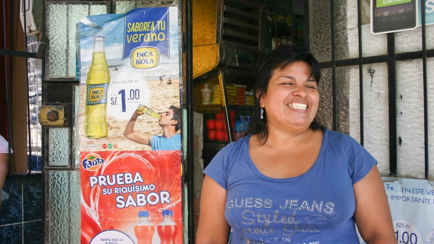 """Maria Carmen Castro, 46, of Lima, Peru, is a survivor of MDR-TB — multidrug-resistant tuberculosis. Partners In Health treated her and loaned her money to open a small store. """"Because of my TB and thanks to God and Partners In Health, now I have my own business,"""" she says."""