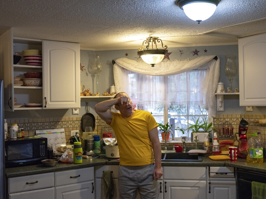Chuck Coma in his mother's kitchen. Since his return from a federal prison in Butner, N.C., he experiences flashbacks from war and his time in jail.