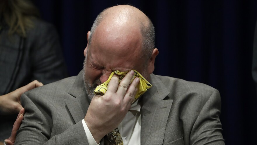 Former priest James Faluszczak, who says he was molested as a teenager by a priest, reacts as Pennsylvania Attorney General Josh Shapiro speaks during a news conference at the Pennsylvania Capitol in Harrisburg on Tuesday.