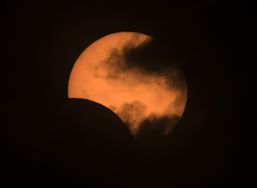 The solar eclipse as seen from the Congreso neighborhood of Buenos Aires, Argentina, on July 2.