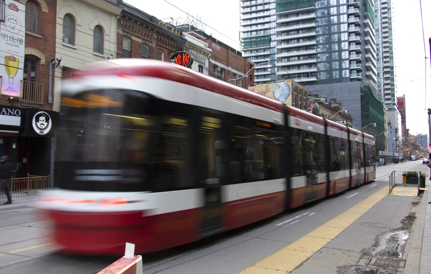 A streetcar rolls down King Street in downtown Toronto. Most car traffic has been diverted from this section of the street.