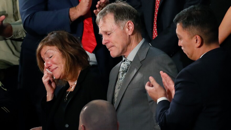 The teary-eyed parents of Otto Warmbier, the American student who died days after being freed from imprisonment in North Korea, react to a standing ovation during President Trump's State of the Union address to a joint session of Congress on Jan 30. The parents filed a wrongful death lawsuit against North Korea on Thursday, saying its government tortured and killed their son.