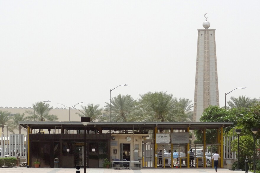 A mosque is seen behind the entrance gate to the headquarters of Saudi Aramco in Dhahran in 2016.