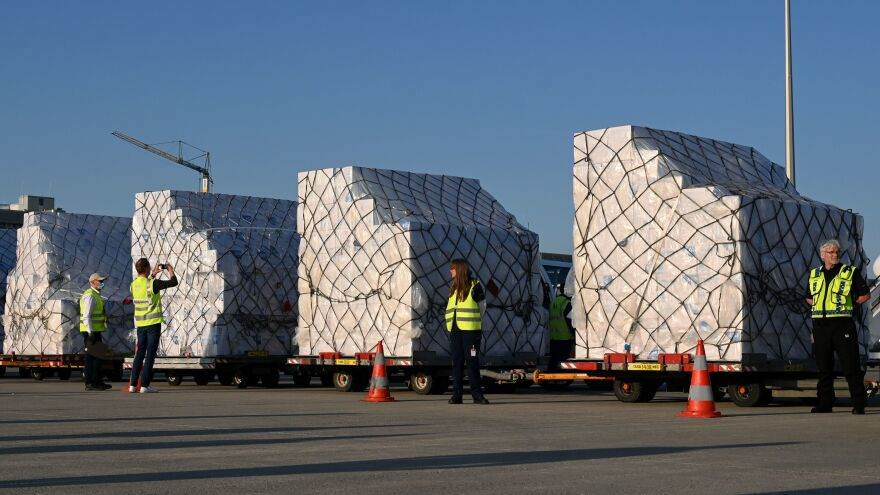 Batches of 8 million protective masks are unloaded from a Lufthansa airplane at the Franz Josef Strauss airport in Munich on Tuesday after arriving from Shanghai.