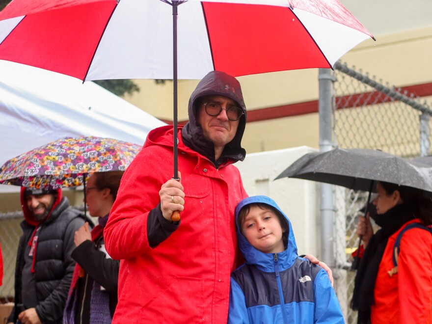 """Teacher Ed Weber brought his son Jasper, 8, with him to the picket line on Monday. """"If we don't stand up now, the quality of our education will continue to be eroded,"""" Weber says."""