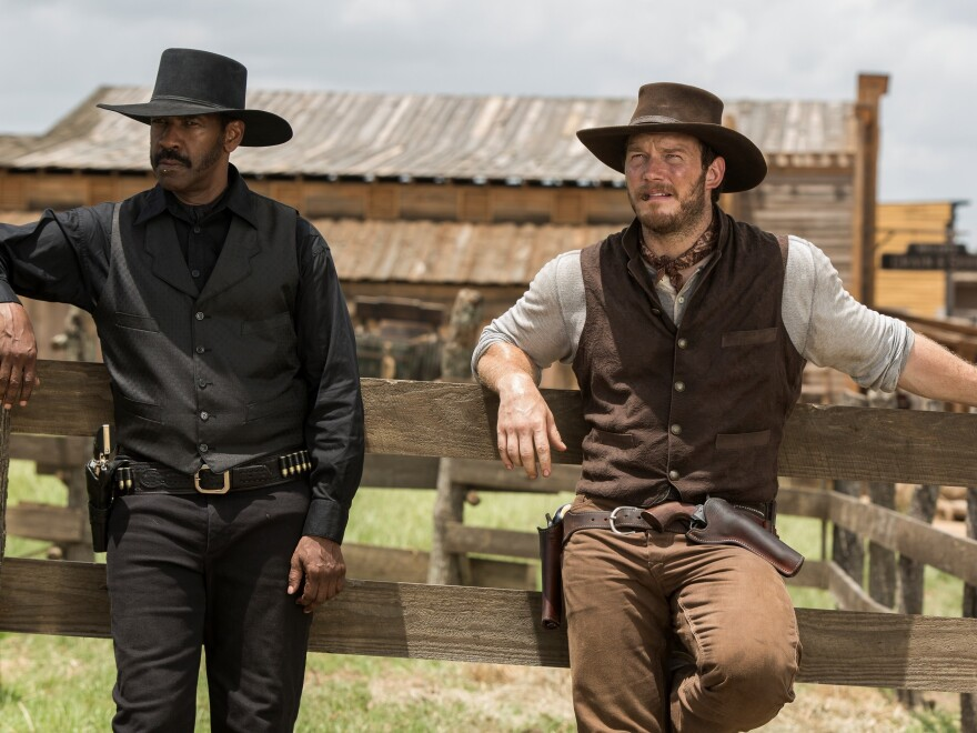 Denzel Washington and Chris Pratt in <em>The Magnificent Seven</em>.
