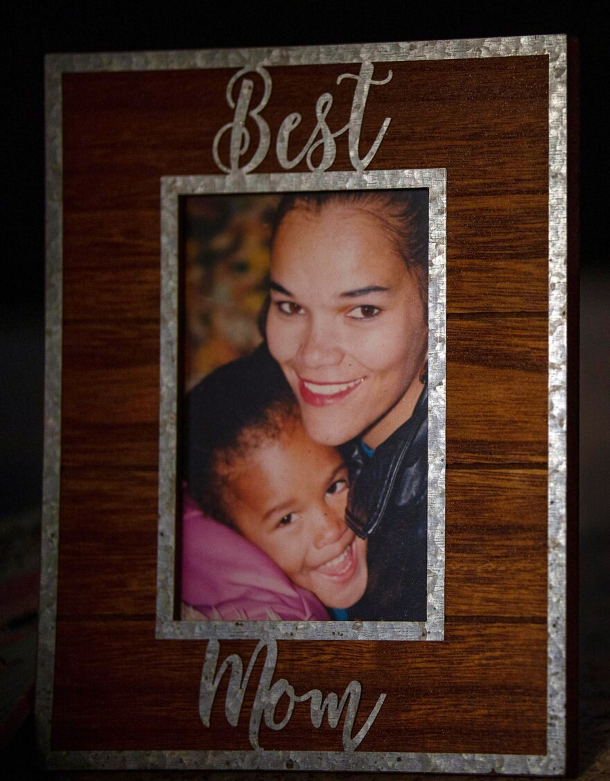 Martina Faulk, and her daughter, Nadia King, embrace in a photograph