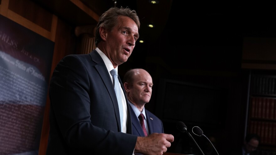 Sen. Jeff Flake, R-Ariz. (left), and Sen. Chris Coons, D-Del., speak to members of the media during a news conference Wednesday on the Special Counsel Independence and Integrity Act.