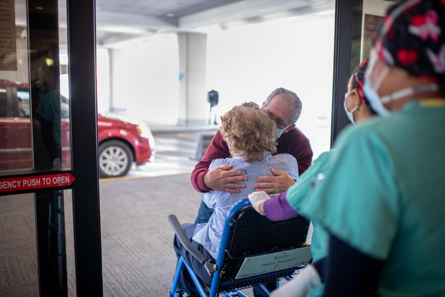 Celeste Marx greets her husband, Len, after spending more than three weeks at St. Luke's Hospital in Chesterfield.