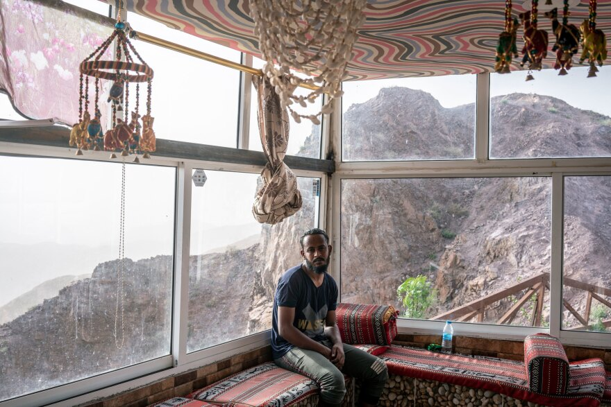 Awadallah Suleiman, a Sudanese migrant worker taking care of an empty souvenir shop on the road from Amman to Petra. The coronavirus pandemic has brought Jordan's vital tourism industry to a dramatic halt, and with it, the livelihoods of hundreds of thousands of workers.