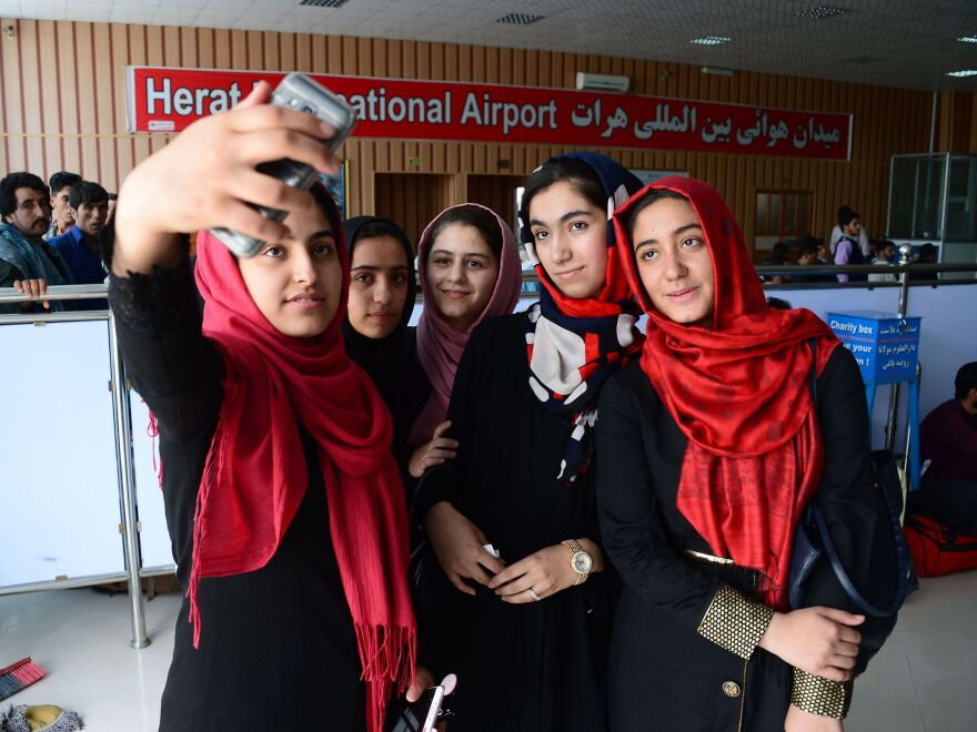 After twice being denied visas, a team of Afghan girls, who stopped for a photo at Herat International Airport in western Afghanistan on Thursday, has been permitted to travel to the U.S. for a robotics competition.