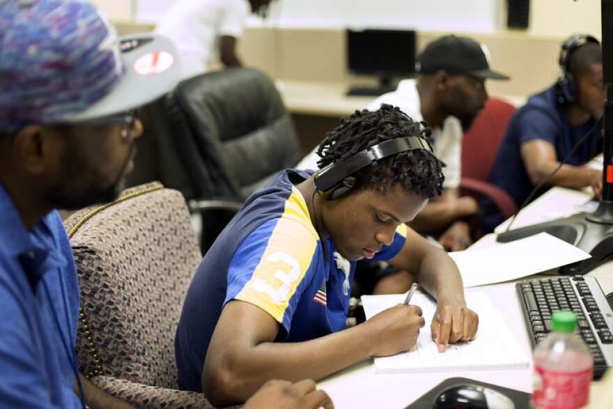 Workforce High School student Deobra Williams works with his mentor James Kern.