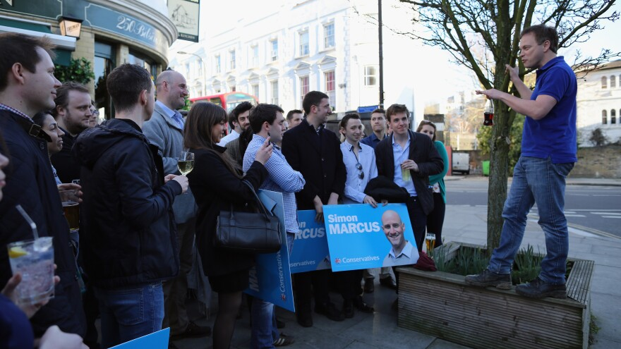 Conservative party Chairman Grant Shapps speaks to party supporters after canvassing in London on Saturday.