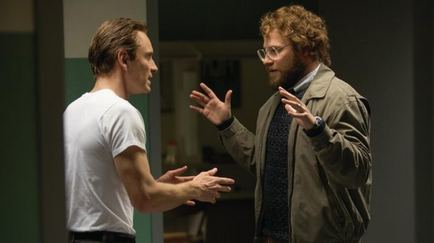 The tension in <em>Steve Jobs</em> comes partly from the terrific performances and partly from juxtaposing Jobs' public and private personas. Michael Fassbender (left) portrays Jobs; he's shown here with Seth Rogen, as Steve Wozniak.