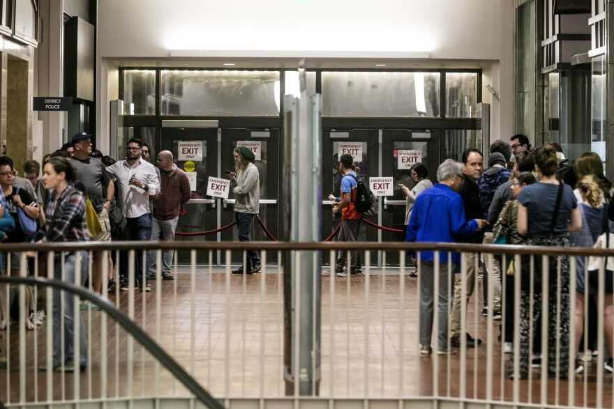 A line of voters wraps through a hallway at ACC Highland mall.