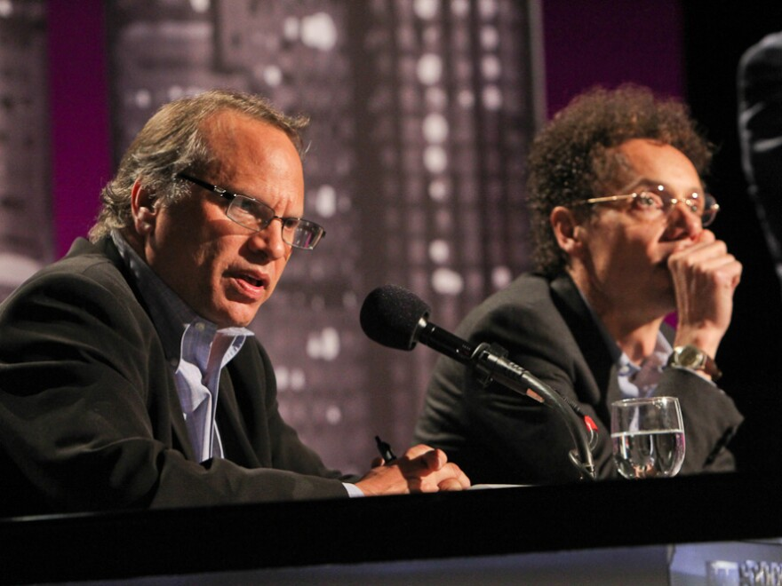 Buzz Bissinger (left) and Malcolm Gladwell argue for banning college football in an <em>Intelligence Squared U.S.</em> debate.