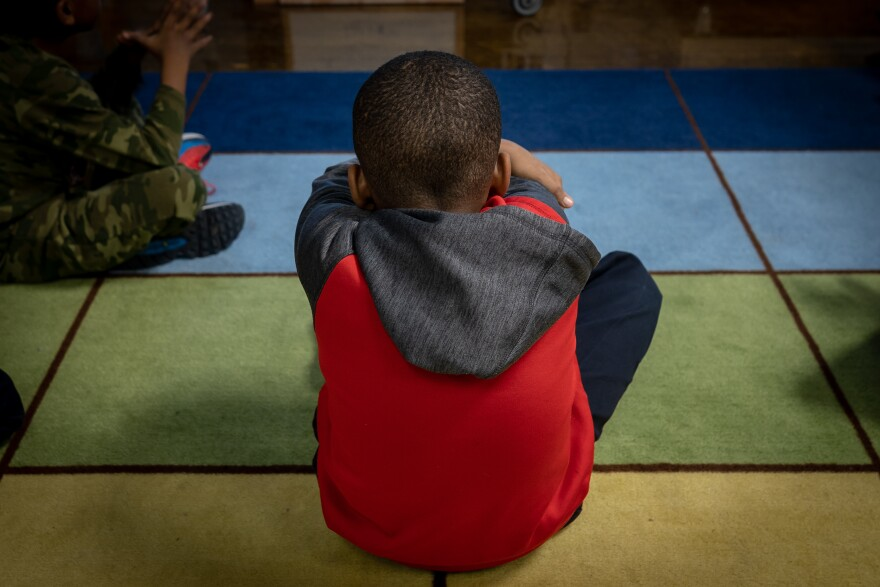 A student at Ashland Elementary School in St. Louis does a mindfulness exercise. The school uses the practices to help its children regulate trauma caused by violence and poverty. Jan. 8, 2019.