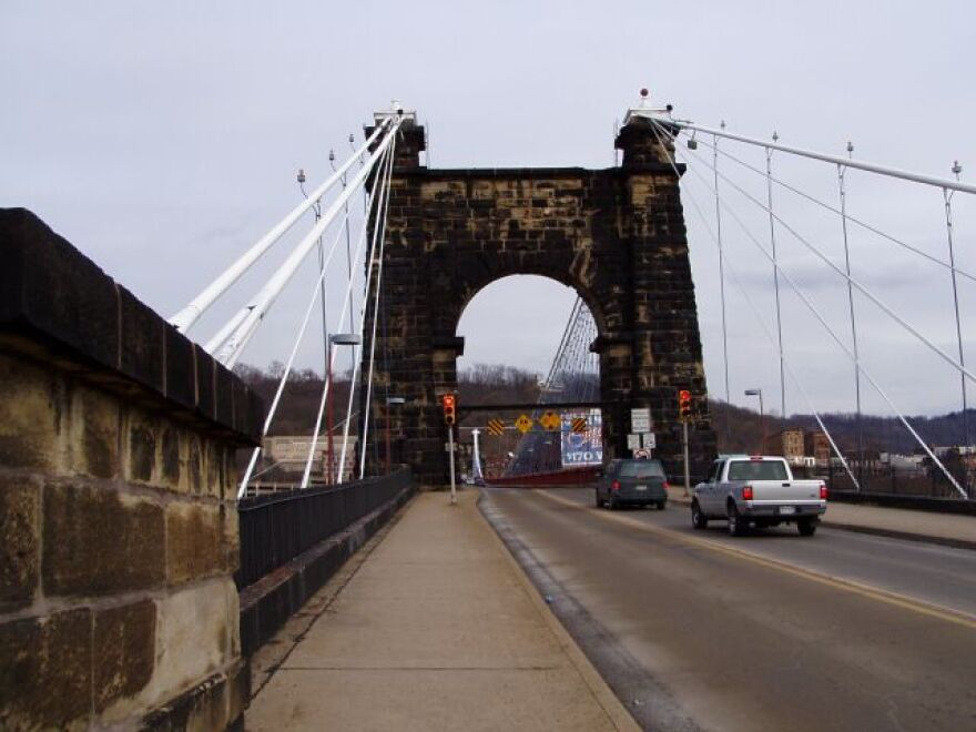 Wheeling_Suspension_Bridge_west_approach_Wheeling_Island_West_Virginia.jpg