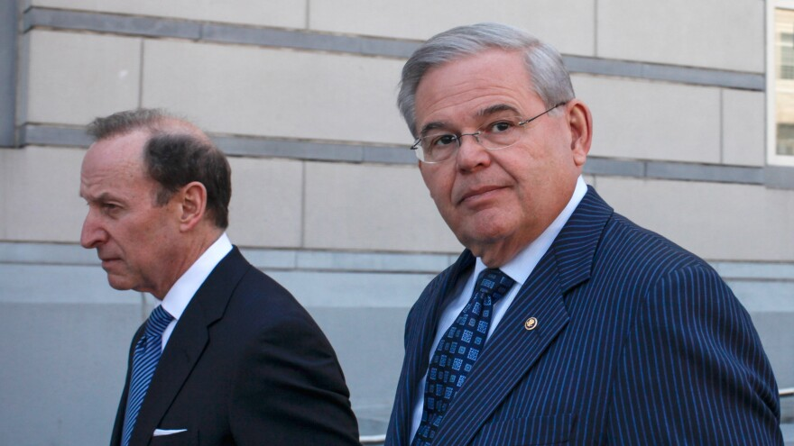 U.S. Sen. Robert Menendez, D-N.J., (right) speaks alongside his lawyer, Abbe Lowell, after being indicted on corruption charges in April.