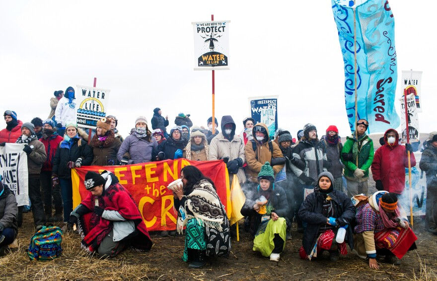 People protesting the Dakota Access Pipeline demonstrate at the Standing Rock Sioux Reservation in North Dakota on Thanksgiving Day 2016.