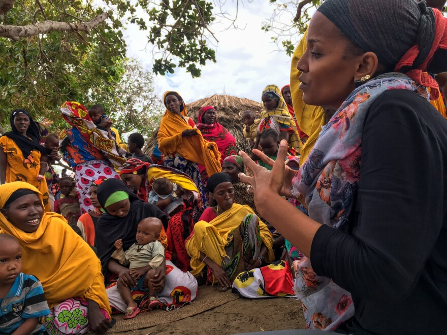 Umra Omar, founder of Safari Doctors, talks with women in a coastal Kenyan village. The group's medical professionals volunteer monthly to provide medical attention to people isolated by geography and the militant group al-Shabab.