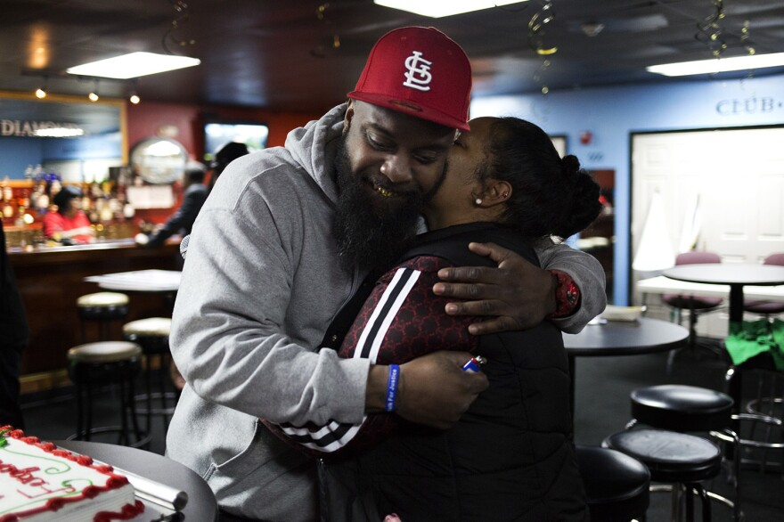 Michael Brown Sr. congratulates Griffin on her city council win two weeks ago at Club Diamonds.