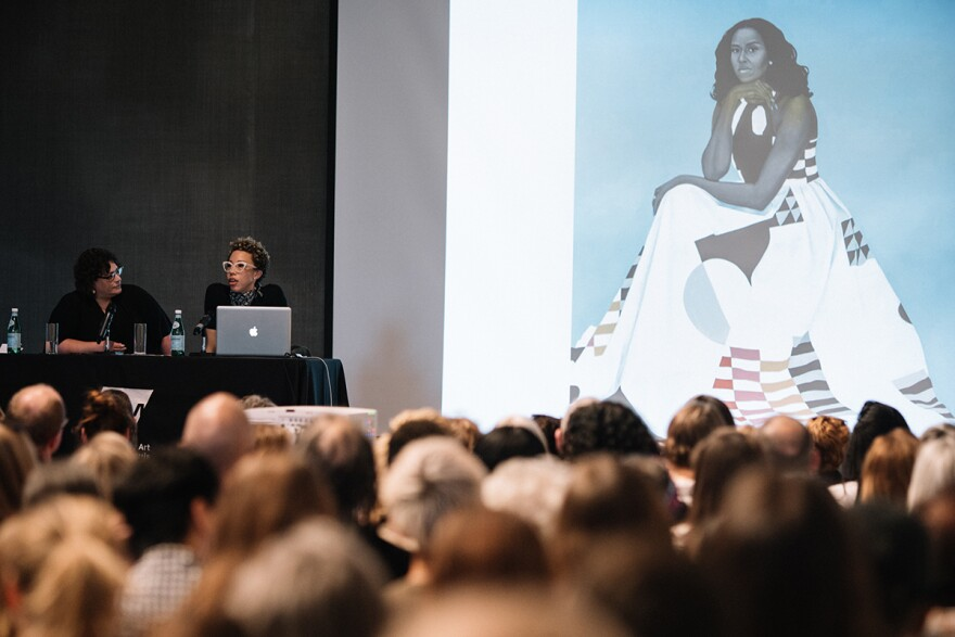 Contemporary Art Museum director Lisa Melandri and Amy Sherald during Sherald's artist talk at the museum. An image of her portrait of Michelle Obama is projected behind them. 5/18/18