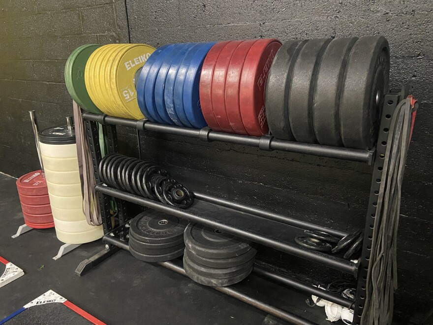 Marks loaned weighted plates and exercise bands to his clients while his gym was shut down because of the pandemic.