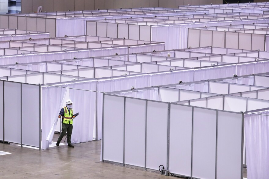 Construction at the COVID-19 field hospital at McCormick Place in Chicago on April 10. The city pared back plans for a 3,000-bed temporary hospital at the nation's largest convention center as infection numbers decreased.