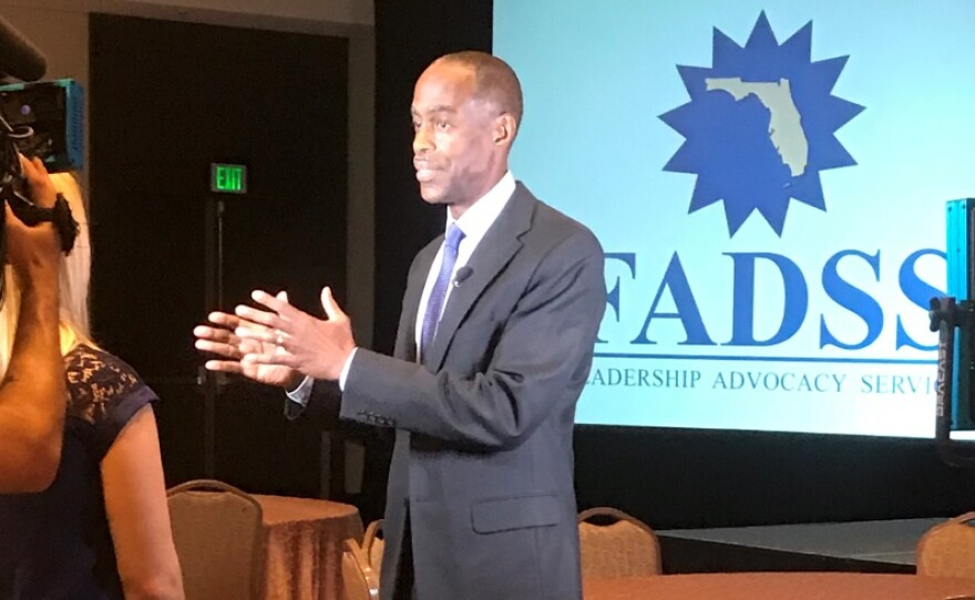 Broward Superintendent Robert Runcie speaking to a reporter at a mental health summit he hosted.